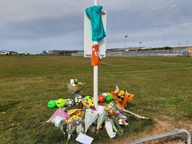 Flowers and football have been left at the scene in tribute to the 9-year-old boy who died on the Common Edge playing fields in South Shore yesterday (Tuesday, May 11)