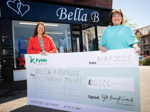 Fylde Council leader Coun Karen Buckley presents the grant money to Bella B owner Alisha Rayson