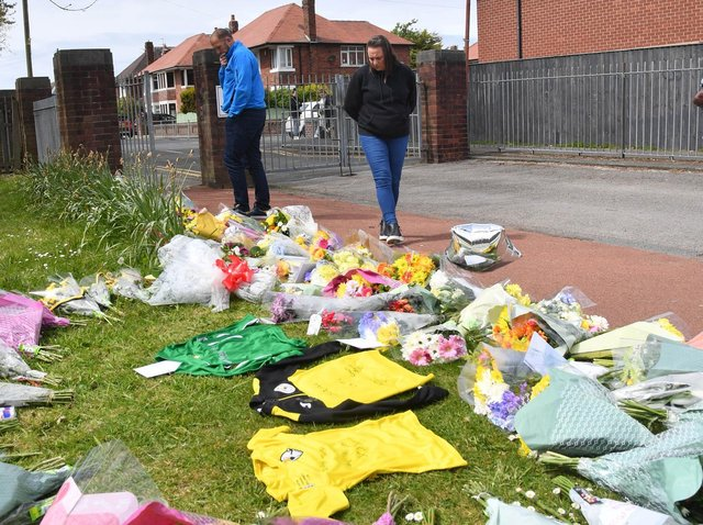 Flowers and football shirts left in memory of Jordan Banks