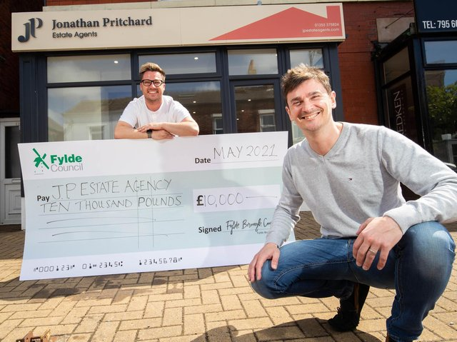 Estate agent Jonathan Pritchard (right) is presented with the grant cash by Coun Michael Sayward outside the premises in Station Road, Lytham