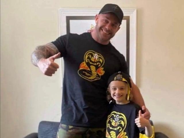 Jordan, 9, with his dad Matt Banks, pictured wearing their Cobra Kai t-shirts together