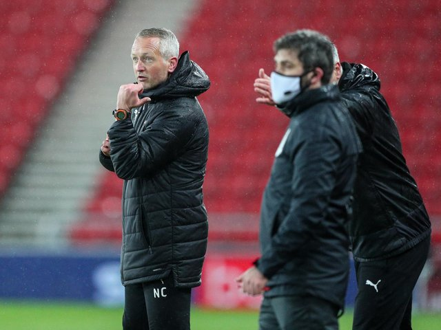 Neil Critchley takes his Blackpool squad into play-off action tomorrow
