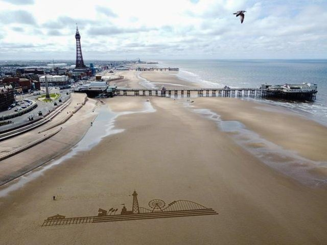 To mark the big day, a 70m etching of the town's skyline – including the Tower, Central Pier's big wheel, and the Big One – was raked into the sand on the beach.