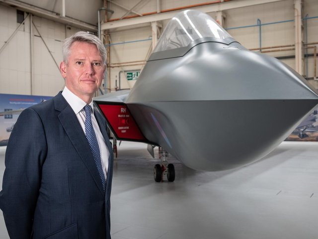 BAE Systems' chief executive Charles Woodburn pictured at Warton with the full sized mock-up of the next generation combat aircraft project, Tempest