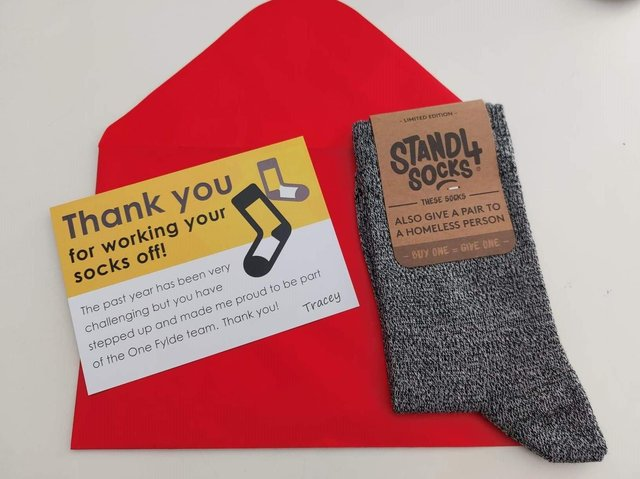 Staff said that their employer's decision to thank them with a pair of socks when many of them are struggling to get by was 'insulting' and 'dehumanising'