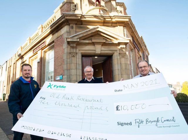 James and Andrew Booker of the Old Bank Restaurant in Kirkham receiving their grant cheque from Coun Richard Redcliffe