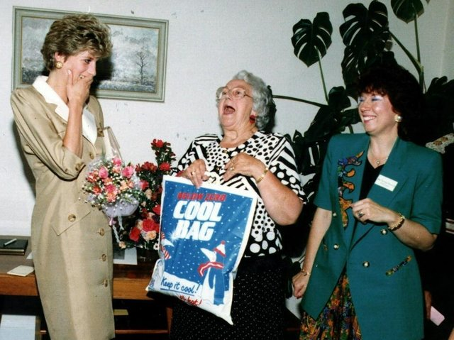 Princess Diana Princess of Wales, shares a joke with Chairman Kath Hayward and manager Marilyn Symonds at Relate Blackpool as she accepts a bag of gifts - including some Fleetwood Fish in 1992