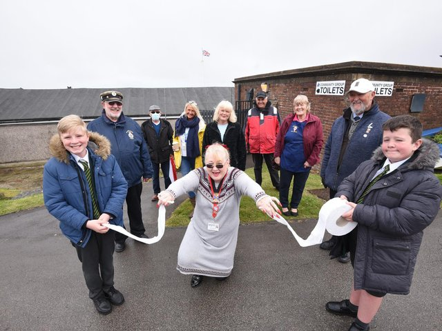 Grand reopening of refurbished toilets on Laidleys Walk in Fleetwood. Kalvin Townsend and Jack Anderton from Shakespeare Primary hold the toilet paper for Coun Mary Stirzaker to cut.