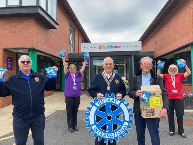 L-R: Rotarian Roger Critchley, staff member Shorni Foster, club president Stuart Boaler, staff member Janet Miller and Rotarian Brian Smith. Photo: Poulton Rotary Club