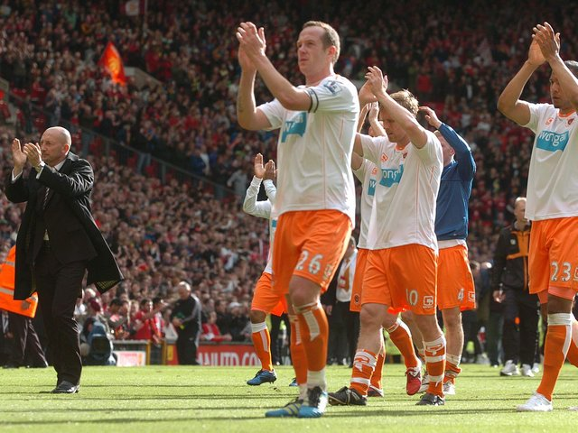 Blackpool players and manager Ian Holloway applaud the fans after their season ended in relegation