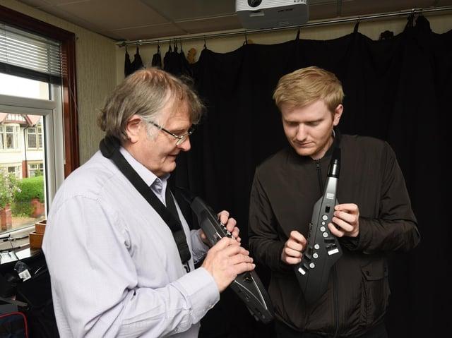 BMS saxophone tutor Ray Jones and reporter James Graves