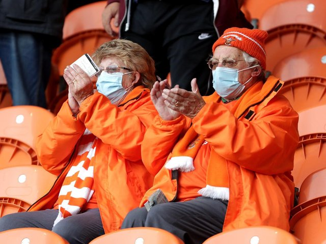 Two Blackpool fans saluting the club's progress to the Wembley play-off final with a 6-3 aggregate win in the semi-finals clinched at Bloomfield Road