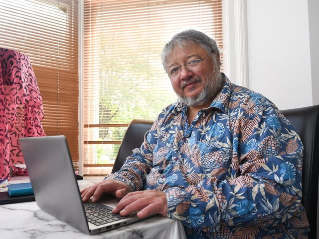 Author David Menon working at his home in St Annes