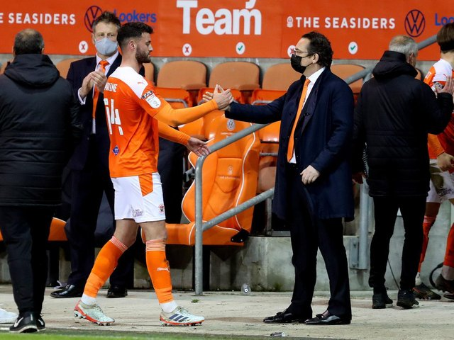 Blackpool owner Simon Sadler with Gary Madine at the end of the play-off semi-fianl against Oxford United Photographer Paul Greenwood/CameraSport