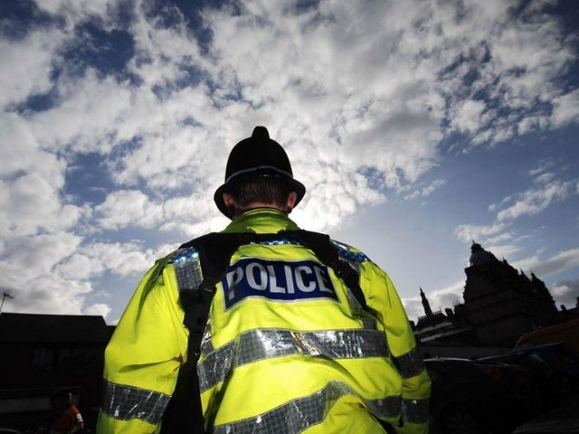 Police saved woman being attacked by a machete