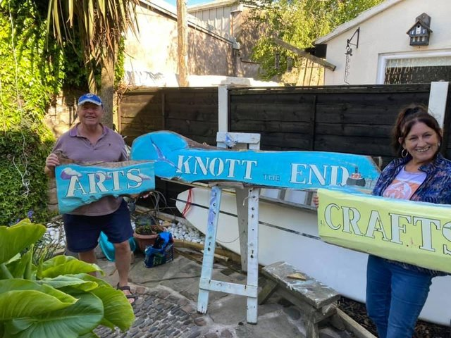 BoatWave Bill presents the new shop sign to Paula Rimmer