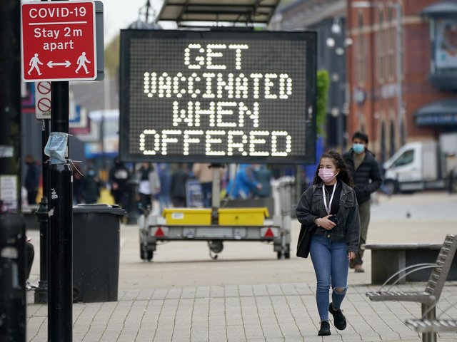 People shop and go about their daily life in Bolton town centre as surge testing and rapid coronavirus vaccinations continue.