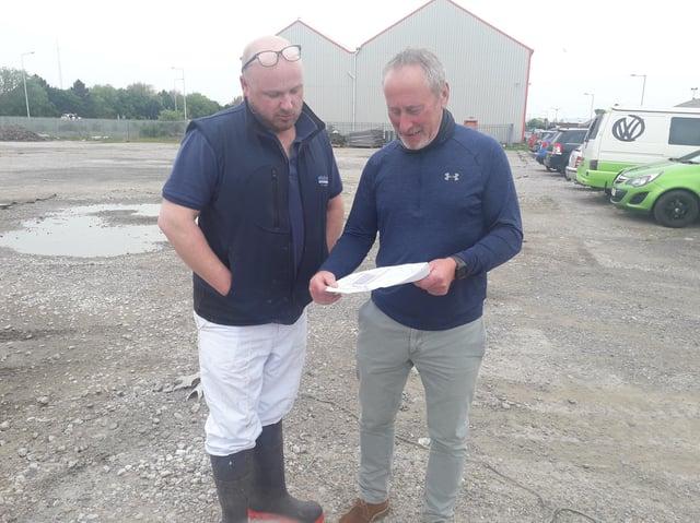 Fish merchants Patrick Hayton (left) and Andrew Riches study Project Neptune plans