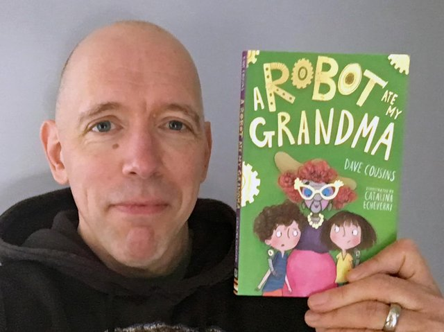 Dave Cousins with his latest book, A Robot Ate My Grandma