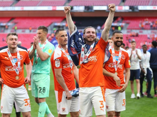 Blackpool's players celebrate their Wembley success