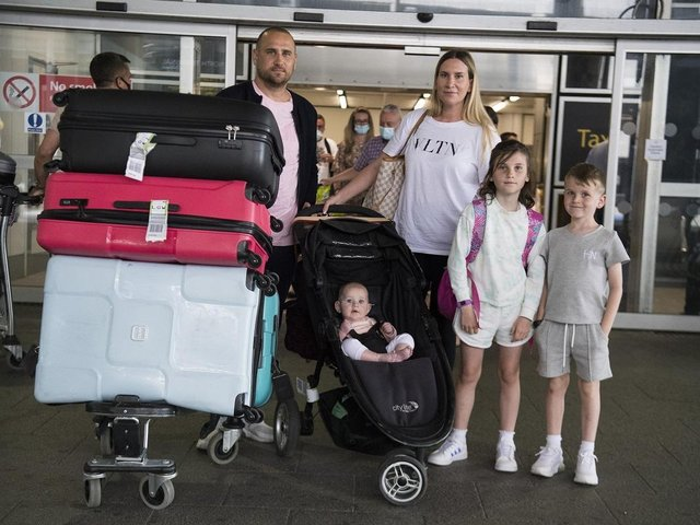 Paul and Jemma Nevard, and their three children (names not given) who live in Bromley, arrive at Gatwick Airport in West Sussex after returning on a flight from Porto Santo in Madeira, Portugal, before Tuesday's 4am requirement for travellers arriving from Portugal to quarantine for 10 days comes into force