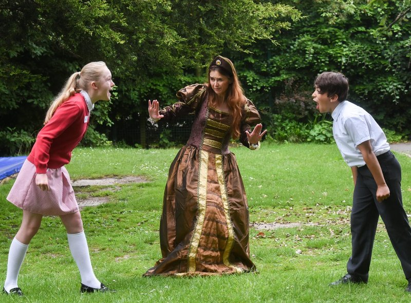 Pupils from Hambleton Primary take part in Shakespeare Day by shouting insults in the style of the Bard. Year 6 pupils Ellie Pangburn and Ashton Wright with director of English Estelle Bellamy. Photos by Dan Martino