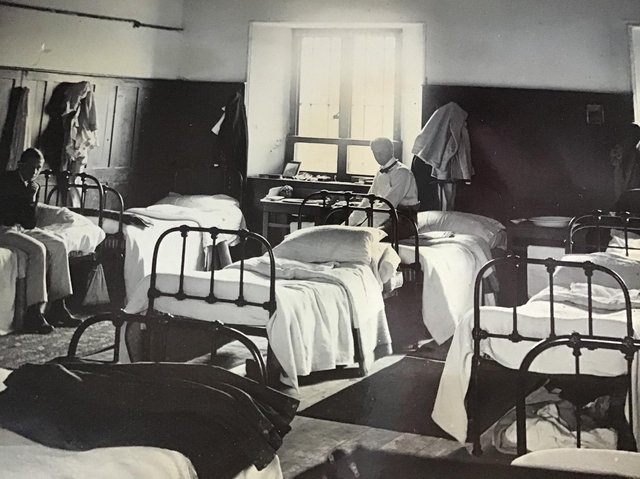 Students relax in one of the dormatories at Rossall School 1890s