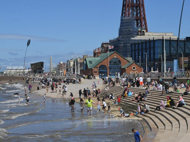Visitors galore enjoying the sea and sands in central Blackpool.