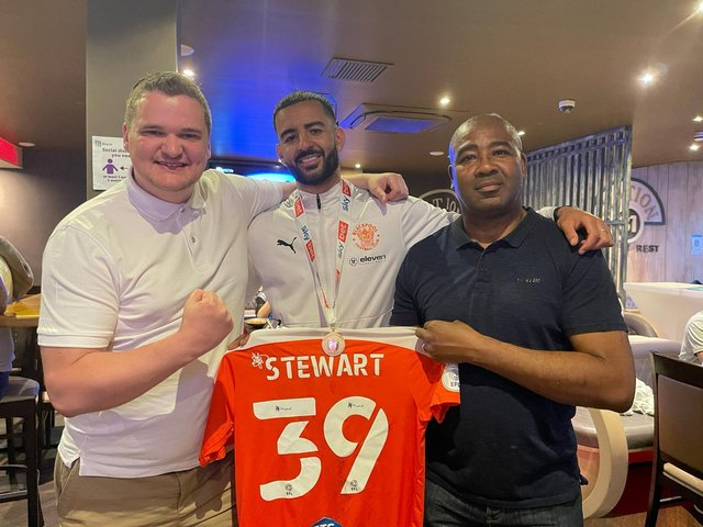 Kevin Stewart (centre) celebrates Blackpool's Wembley triumph with his father (right) and entrepreneur Samuel Leeds