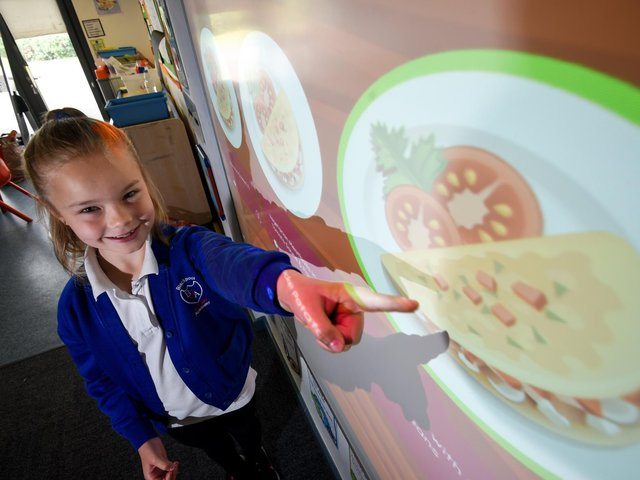 Gateway Academy pupil Abbie French-Hallsworth with the new Cypad touch-screen system, which has been introduced to allow children to independently choose their meals in advance. Picture: Daniel Martino/JPI Media