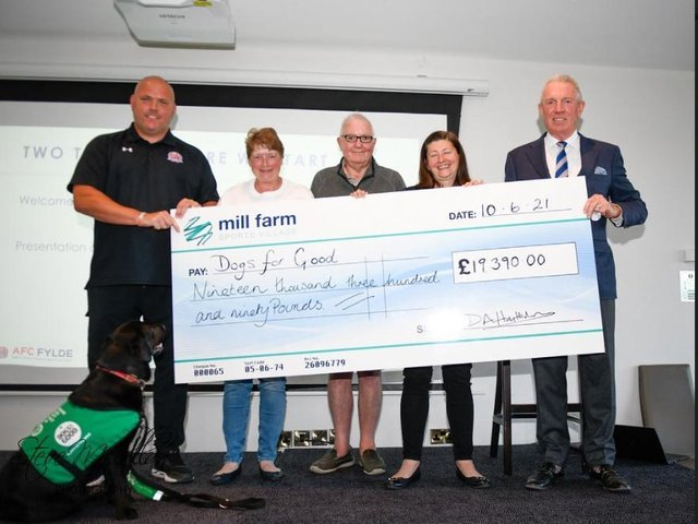 AFC Fylde Chairman David Haythornthwaite and First Team Manager Jim Bentley presented a cheque for £19, 390 to Dogs for Good representatives Charlotte Fryer, her husband Steve and Vicky Blackmore, to help support the work that they do.