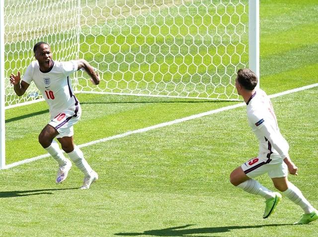 Raheem Sterling celebrates scoring England's winning goal against Croatia.