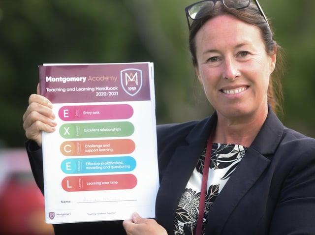 Montgomery Academy's deputy headteacher Amanda Morton, with the international teaching and learning booklet produced by teachers. Photo: Daniel Martino/JPI Media