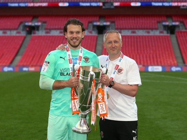 Neil Critchley and Chris Maxwell celebrate Blackpool's promotion
