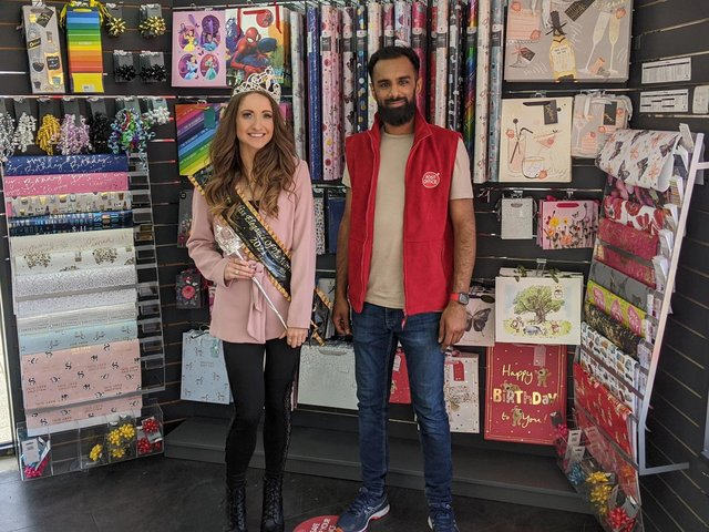 UK winner of Miss Elegance Of The World, Grace Smithen, visited Bispham post office. Pictured with postmaster Qasim Sharif.