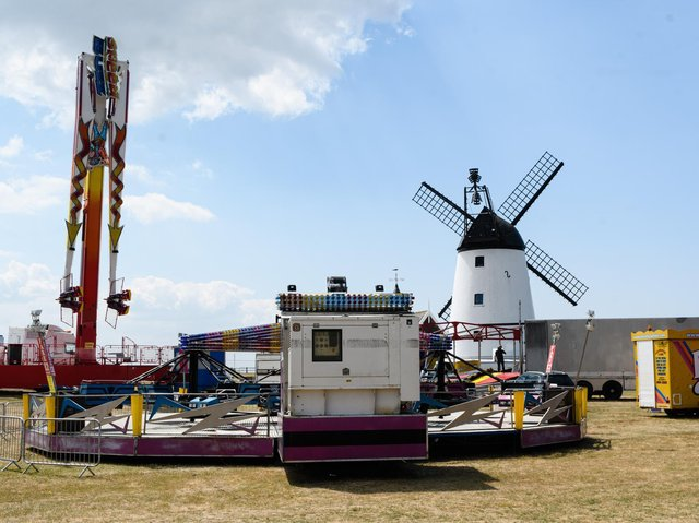 Cubbins funfair being set up in the shadow of the Windmill on Lytham Green