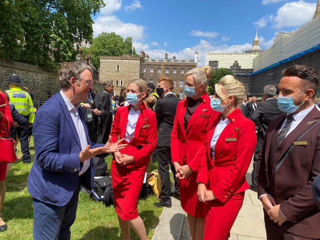 Blackpool North and Cleveleys MP Paul Maynard talks to members of the travel industry at Westminster as a protest over the Government's traffic light travel system takes place