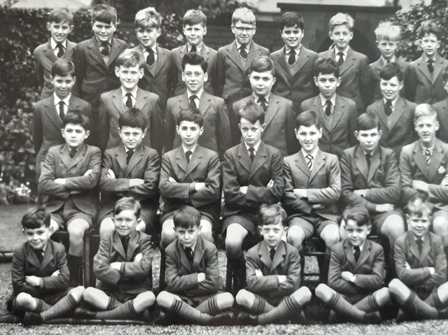 Boys sit smartly for their school photo
