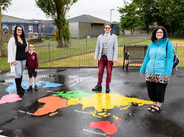 Samantha and Riley-Jay Hindmarch, Paul Galley and Michelle Backhouse with some of the artwork installed in East Pines Park