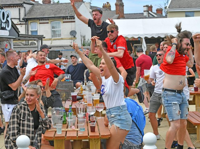 Fans celebrate at No 3 Bar earlier this month