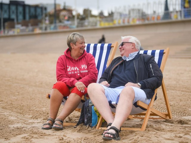 Teresa Everington and Graham Crump are the first ever customers to hire the new deck chairs.
