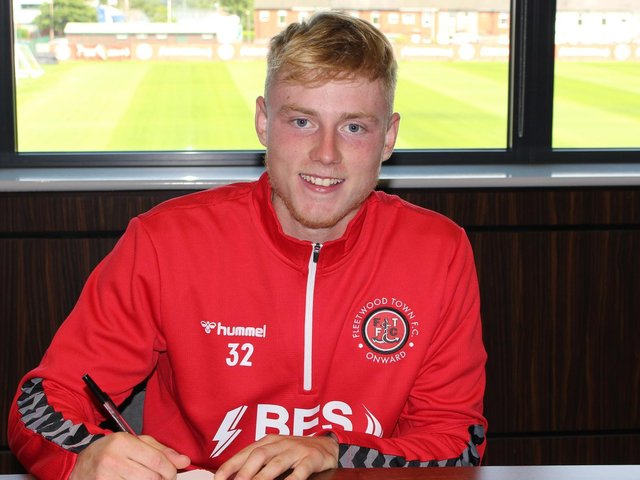 Paddy Lane signs his two-year Fleetwood contract