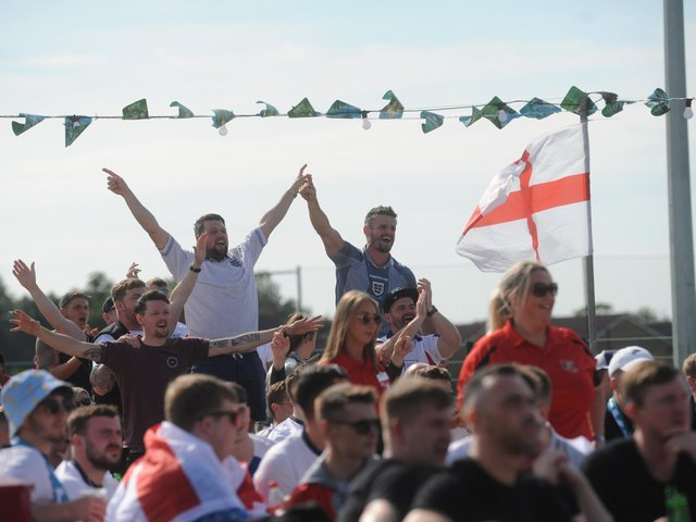 England fans celebrate at Pool Foot Farm in Thornton