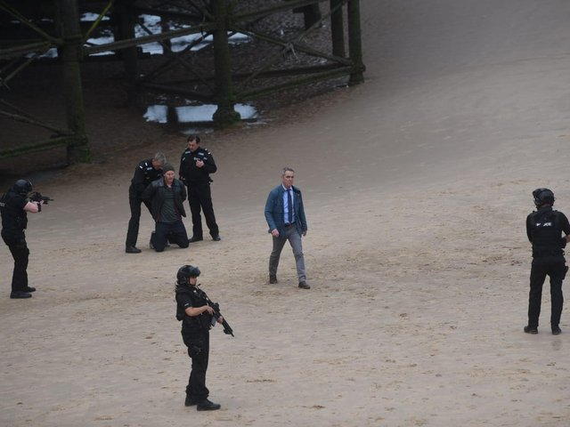Taking centre stage on the beach near Central Pier was actor James Nesbitt, in the role ofa homicide detective, as 'armed police' surroundeda suspect with their guns drawn