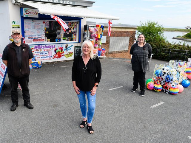 (L-R) William Hargreaves, Gillian Gallagher, Helen Crane outside Dolly's Kiosks who have organised raffles to raise money for a defibrillator at the newly reopened seafront toilet. Photo: Kelvin Stuttard