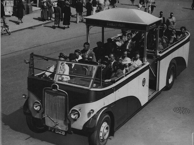 An example of an open-topped runabout bus which had a central canopy