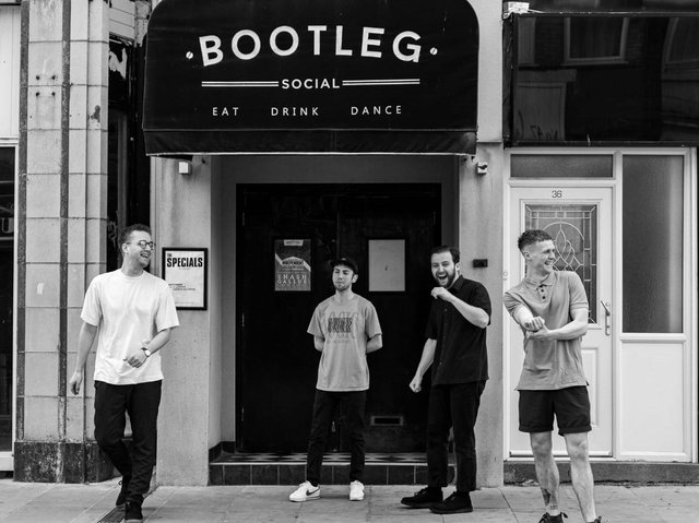 The band Alright, outside Bootleg Social in Blackpool
