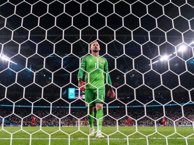 Kasper Schmeichel of Denmark looks dejected after conceding their side's second goal scored by Harry Kane