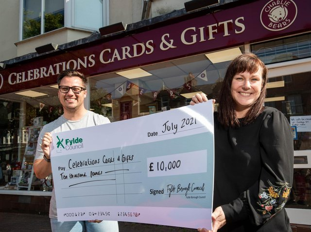 Sarah Mangan of Celebrations Cards and Gifts is presented with the grant money by Coun Michael Sayward outside the Lytham shop