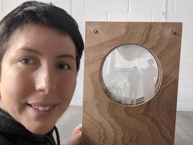Artist Alex Blakey working on one of the Peep Hole Boxes as part of the Kirkham Treasures art installations